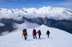 Climbers reaching  Weissmies mountain's summit. Royalty Free Stock Photography