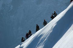 Climbers on ridge. Climbers on alpine ridge in the French Alps, France Royalty Free Stock Image