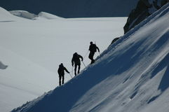 Climbers on ridge. Climbers on alpine ridge in the French Alps, France Royalty Free Stock Photography
