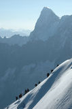 Climbers on ridge. Climbers on alpine ridge in the French Alps, France Stock Images