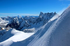 Climbers on ridge in Chamonix. With mountains range on background Royalty Free Stock Photos