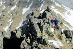 Climbers on the rock and snow alpinist route Royalty Free Stock Images