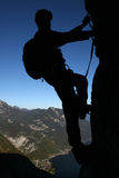 Climbers silhouette. Silhouette of a climber in vertical wall royalty free stock photo
