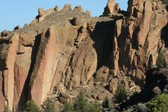 The Dihedrals at Smith Rock. Climbers are dwarfed by towering rock face of The Dihedrals at Smith Rock State Park, Terrebonne, Oregon Stock Image
