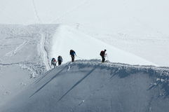 Climbers on snow ridge. Climbers on alpine ridge in the French Alps, France Royalty Free Stock Photography