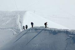 Climbers on snow ridge