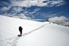 Climbers at the snow slope in Caucasus mountains. Elbrus area. Traces to horizont Royalty Free Stock Photos
