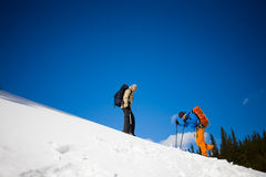 Climbers are on snow slope. Stock Photo