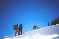 Climbers are on snow slope. Royalty Free Stock Image