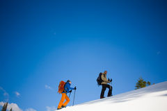Climbers are on snow slope. Stock Photography