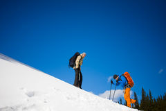 Climbers on a snow slope. Royalty Free Stock Photography