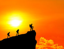 Climbers standing on summit of mountain. Stock Photo