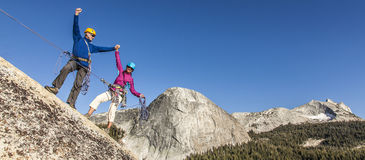 Climbers on the summit. Stock Images