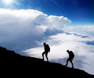 Climbers on summit of a mountain. Royalty Free Stock Image