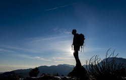 Climbers on the summit of the mountain at sunrise. Mountaineer silhouette model.successfully reach the mountain summit stock photos