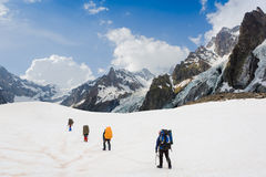 Climbers team in hike. Alps Stock Images