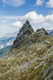 Climbers at the top of the Mnich. Summit in the Tatras in Poland. royalty free stock photos