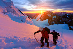 Climbers at the top of a pass Stock Photo