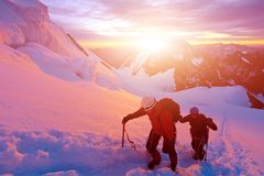 Climbers at the top of a pass Stock Image