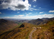 Climbers Traverse near Bowfell, Lake District Stock Photo