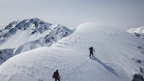 Climbers Walking Up Mountain Expedition Aerial Flight Epic Mountain Range Climb To Success Beautiful Peak Winter. Vacation Exploration Adventure Hiking Tourism stock footage