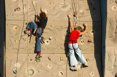 Climbers on a wall. Climbers Royalty Free Stock Image