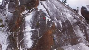 Climbers on the wall. Training climbers on a high rock in a Siberian nature reserve Stolby. stock video