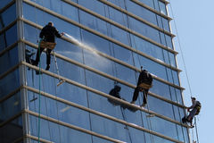 Climbers washermen Windows. Athletes climbers wash Windows in high-rise buildings Stock Photography