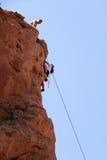 Climbing. Rock climber climbing a cliff Royalty Free Stock Photo