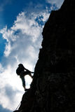 Climbing. Silhouette of a man resting during an ascension on a climbing rock in Retezat mountains