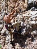 Climbing. Man climbing a natural wall Royalty Free Stock Photo