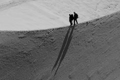 Climbing. Two climbers decent over a ridge. B&W photo Stock Image