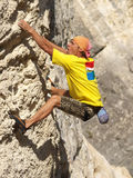 Climbing. Man actively concerns climbing on the rock Royalty Free Stock Image