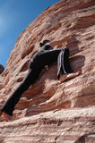 Climbing. A girl climbing a rock wall in Red Rock Canyon, Nevada Royalty Free Stock Photography