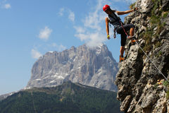 Climbing. Young woman climbing in the Dolomits, Italy Stock Photos