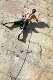 Climbing. Rock climber climbing an overhanging cliff stock images