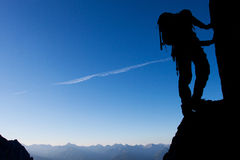 Climbing. Silhouette of a climber with large copy space Stock Photos