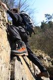 Climbing. Sportsman climbing on a rock Stock Photo