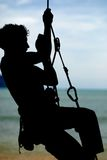 Climbing. Going up a rope climing on the beach Tonsi Thailand Stock Photos