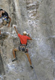 Climbing. Cllimbing on limestone rock in thailand Stock Photo