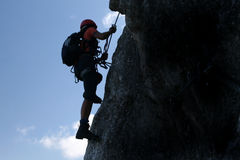 Climbing. Extreme sport - silhouette of a climber Royalty Free Stock Images
