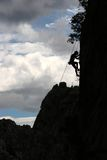 Climbing. Rock climbing silhouette Royalty Free Stock Photos