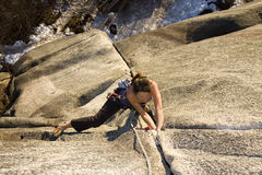 Climbing. A fit and attractive girl climbs a granite rock in Squamish British Columbia Canada Stock Photography