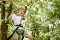 Climbing in adventure park royalty free stock images