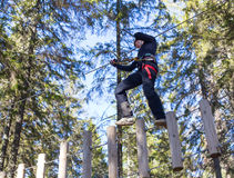 Climbing in adventure park Royalty Free Stock Photos