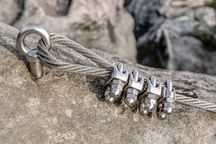Climbing anchor or carabiner attached to rock. Climbing anchor or carabiner attached to the cliff rock. Difficult path for climbing on via ferrata stock photography