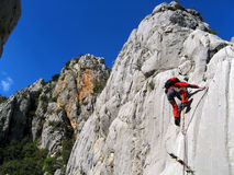 Climbing in beatiful landscape Royalty Free Stock Image