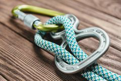 Climbing belay device with rope. Stock Photography