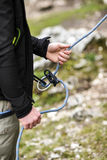 Climbing belayer holding rope in his hands.  Royalty Free Stock Photos