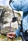 Climbing belayer holding a rope, outdoor. Jura krakowsko czestochowska. Stock Image